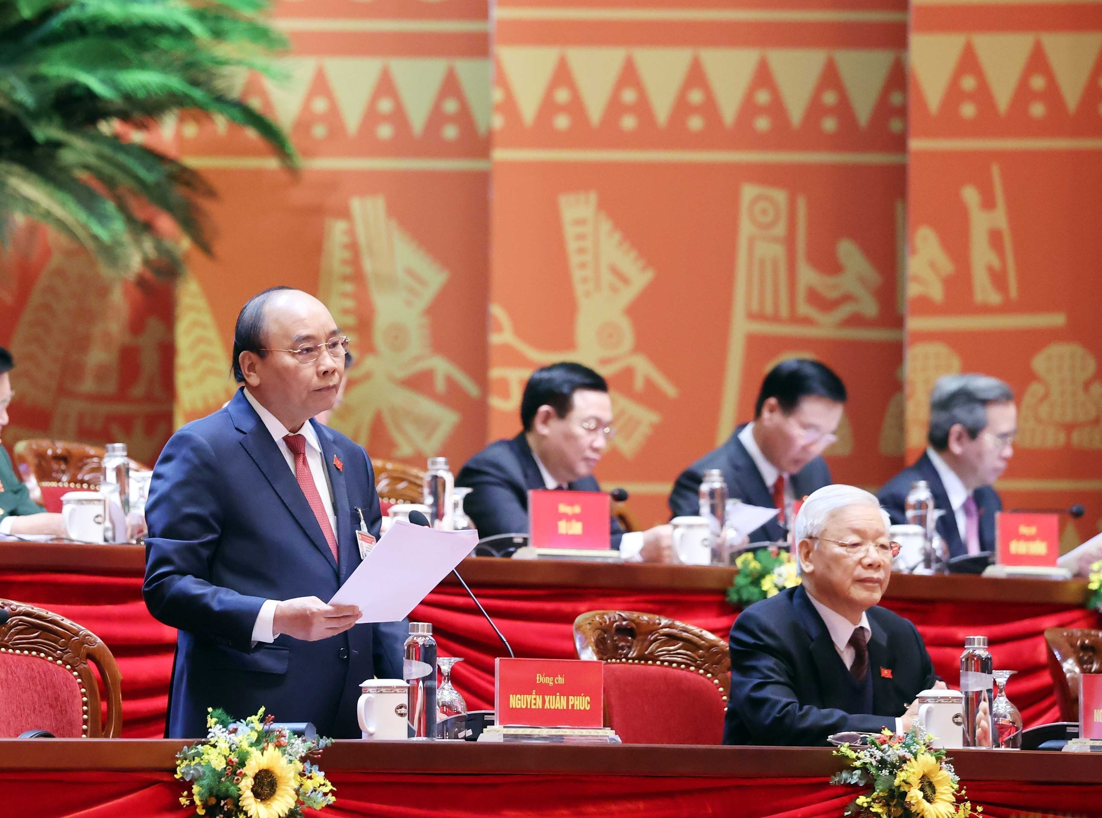 Congress delegates discuss documents on third working day hinh anh 8