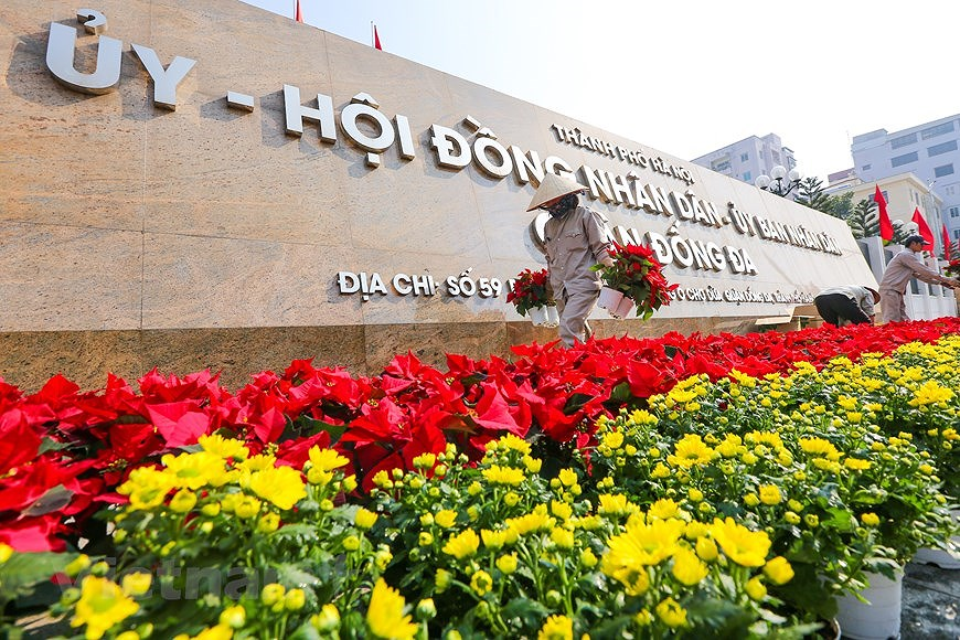 """Hanoi wears """"new coat"""" to welcome 13th National Party Congress hinh anh 21"""