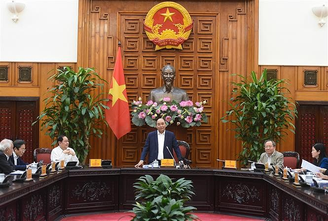 PM chairs meeting of compilation board for book on Government history hinh anh 1