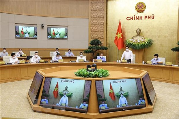 Prime Minister Pham Minh Chinh chairs first regular Government meeting hinh anh 2