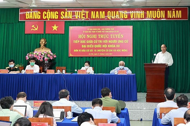 State President meets voters in HCM City's Cu Chi and Hoc Mon districts hinh anh 1