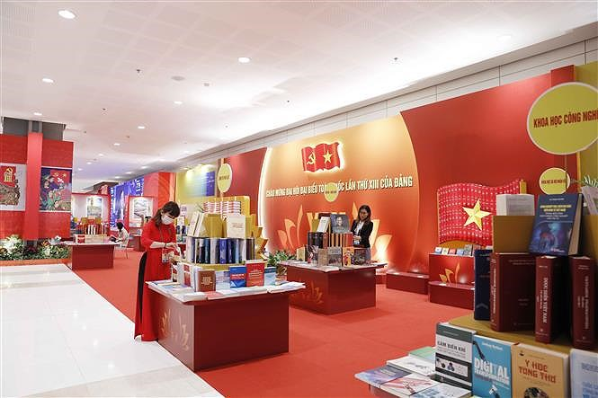 Books, newspapers on showcase to mark Party Congress hinh anh 7