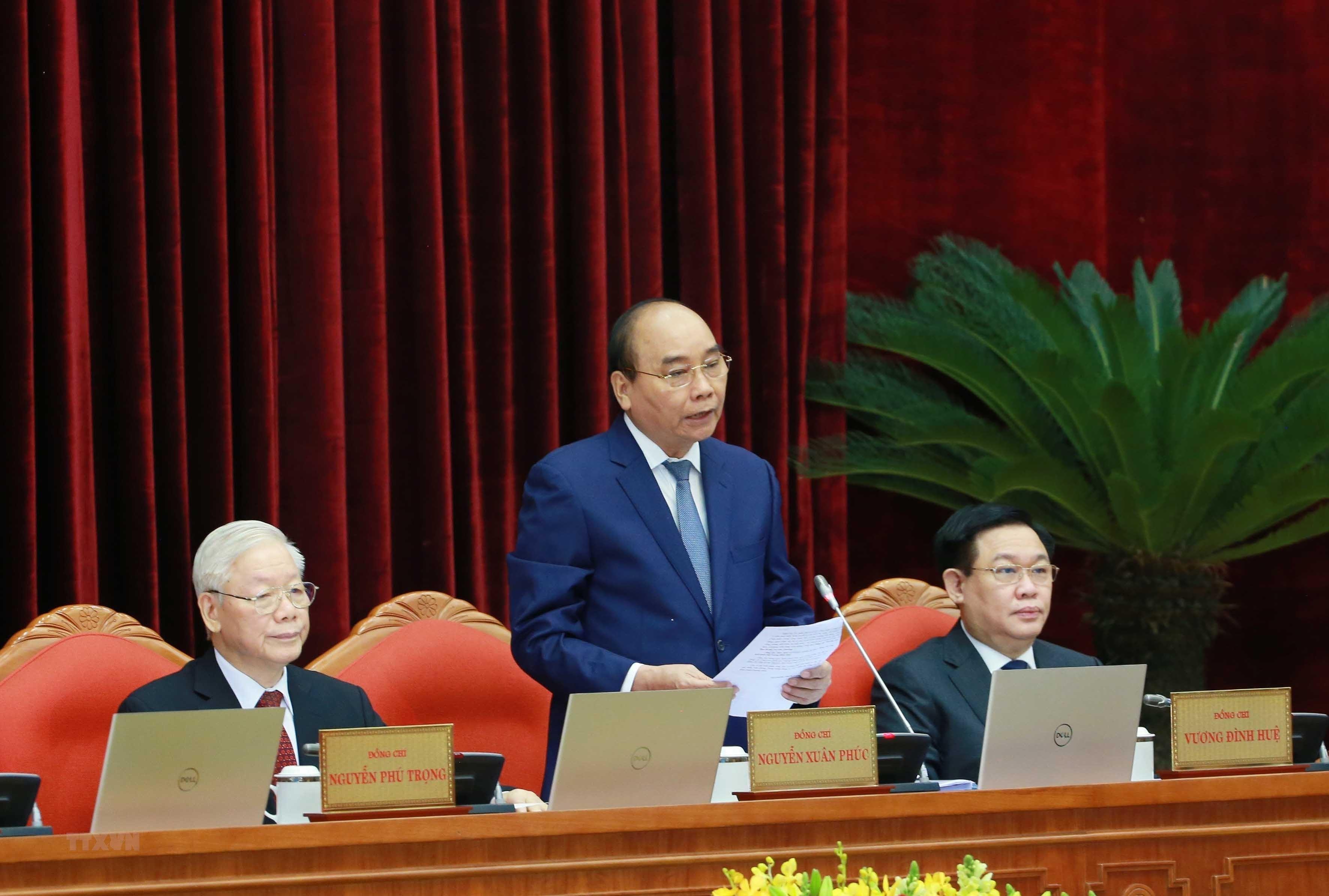 [Photo] Hoi nghi lan thu tu Ban Chap hanh Trung uong Dang khoa XIII hinh anh 10