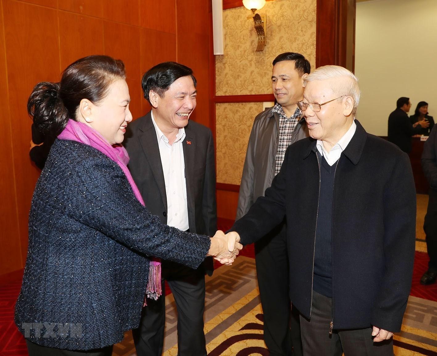 [Photo] Tong Bi thu chu tri hop Tieu ban Van kien DH XIII cua Dang hinh anh 5