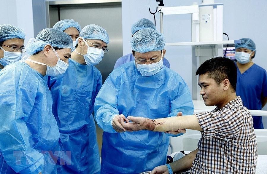 [Photo] Dai hoi Dang XII: Buoc vao ky nguyen hoi nhap va phat trien hinh anh 36