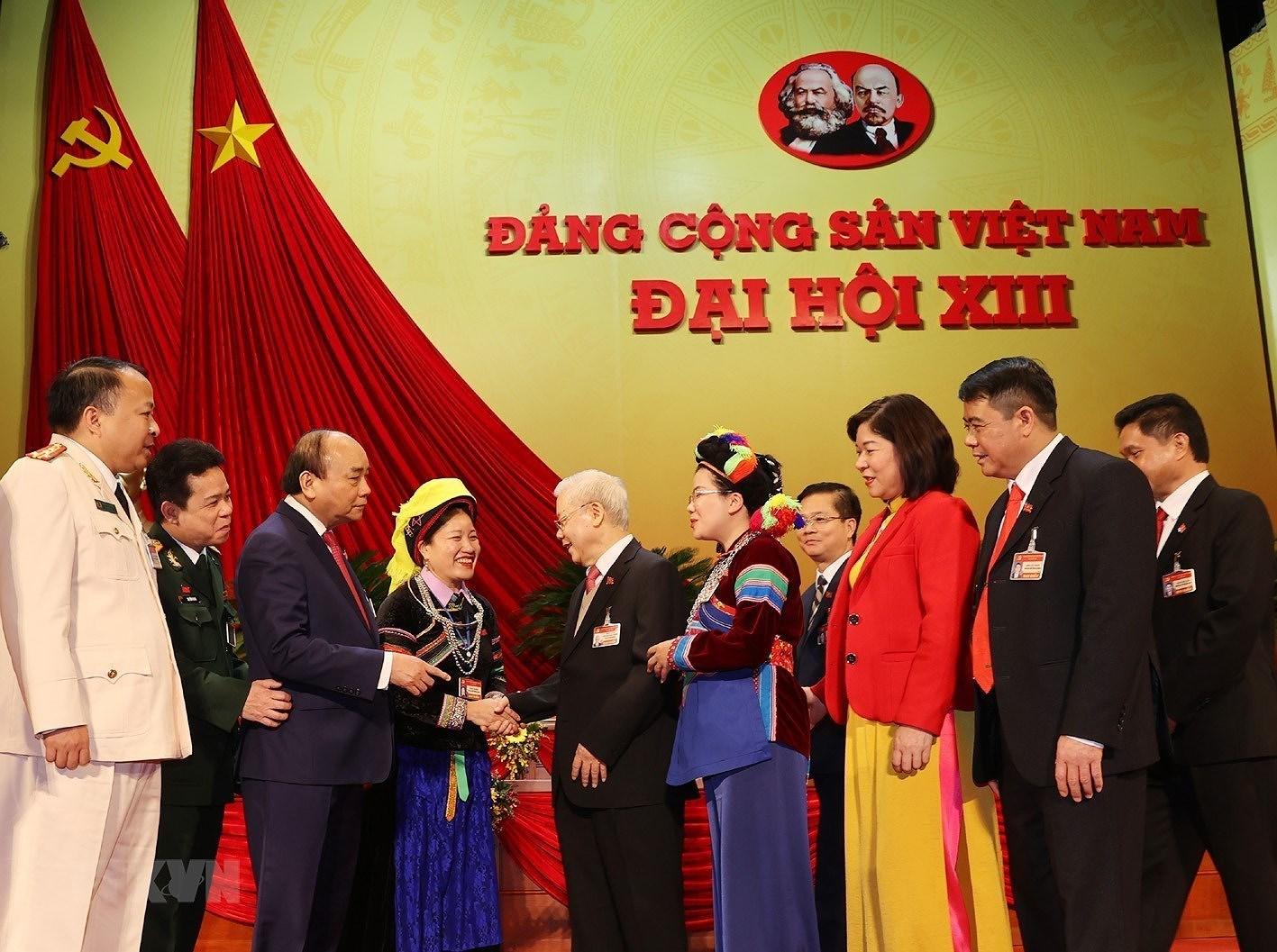 [Photo] Ngay 29/1, Dai hoi XIII tiep tuc lam viec ve cong tac nhan su hinh anh 1