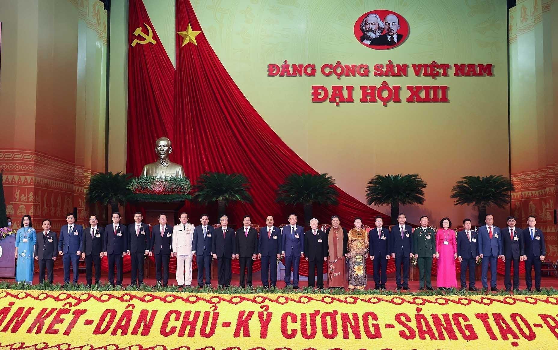 [Photo] Ngay lam viec thu nam Dai hoi lan thu XIII cua Dang hinh anh 15