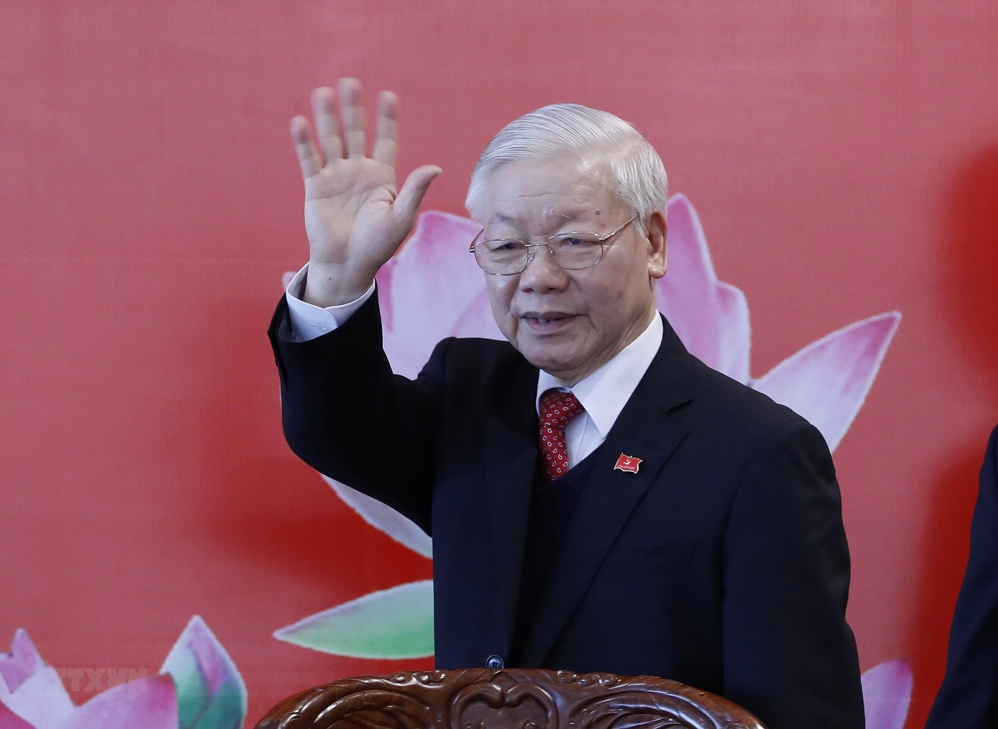 [Photo] Tong Bi thu Nguyen Phu Trong chu tri hop bao sau DH Dang XIII hinh anh 1