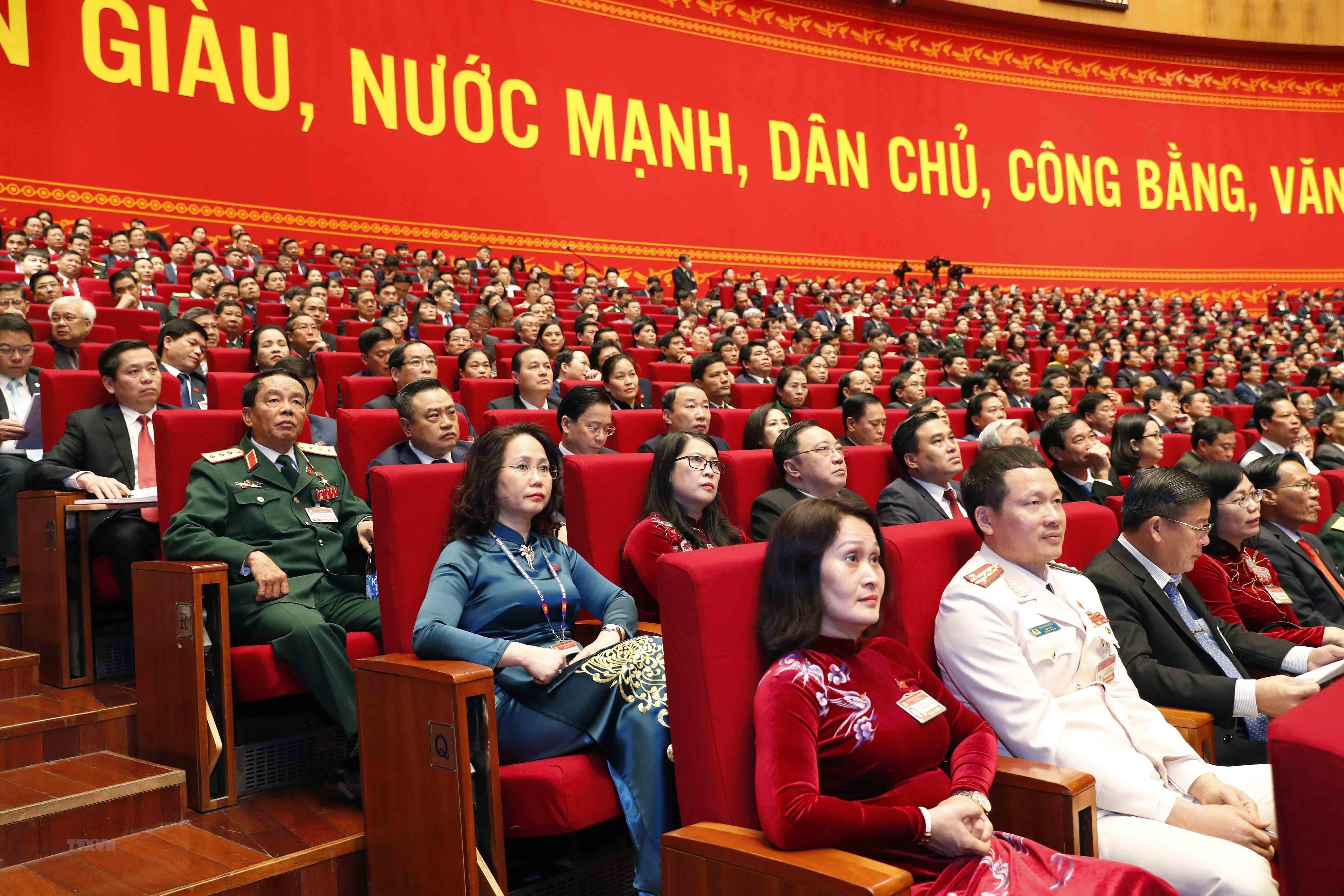 [Photo] Quang canh phien thao luan cac van kien Dai hoi XIII cua Dang hinh anh 17