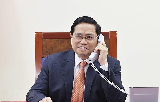越南政府总理范明政与新加坡总理李显龙通电话 hinh anh 1