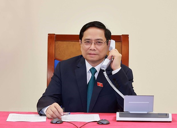 Lao Prime Minister makes phone call to congratulate Vietnamese counterpart hinh anh 1
