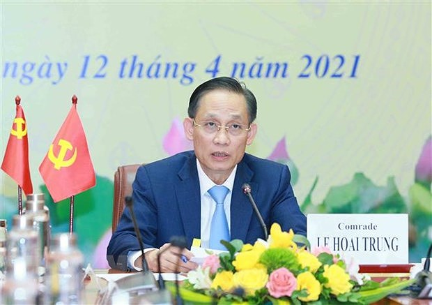 Teleconference informs outcomes of 13th CPV Congress to Chinese party hinh anh 1