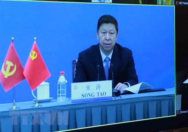 Teleconference informs outcomes of 13th CPV Congress to Chinese party hinh anh 2