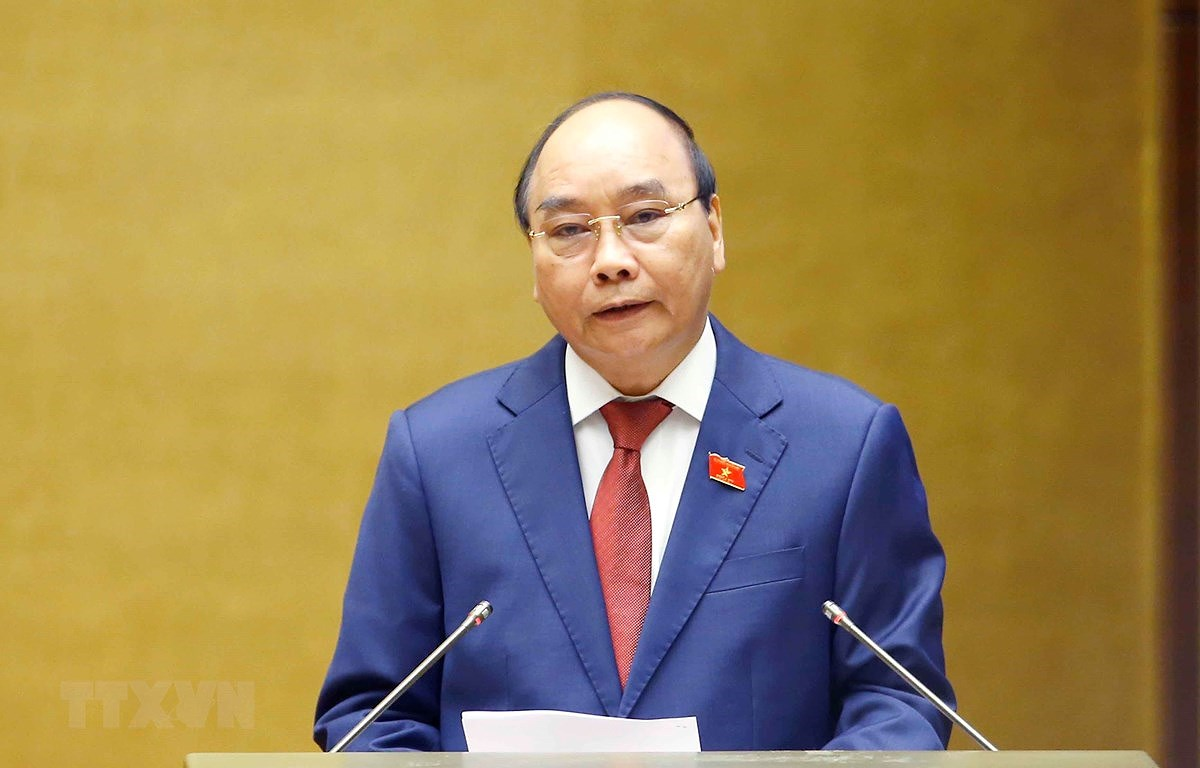 President to pay official friendly visit to Laos next week hinh anh 1