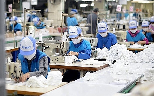 More tax, fee cuts to benefit pandemic-hit enterprises, people hinh anh 1