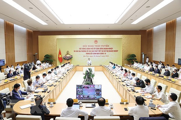 PM, business circle discuss ways to tackle pandemic-caused difficulties hinh anh 2