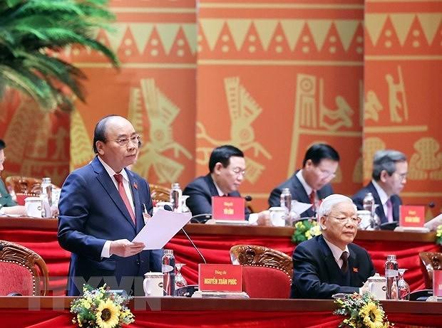 Съезд обсуждает проекты документов о партиином строительстве и национальном развитии hinh anh 1